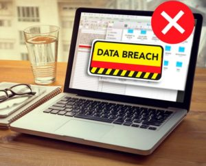 laptop with a data breach - avoid cybercrime